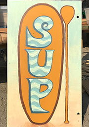 hand-painted sign for OASIS rental sup